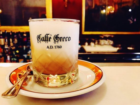 coffee in glass with milk on saucer at caffe greco rome italy