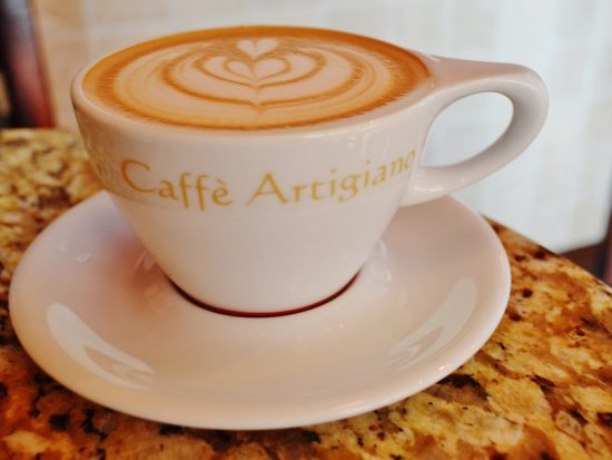 cup of cappuccino on saucer at caffe artigniano